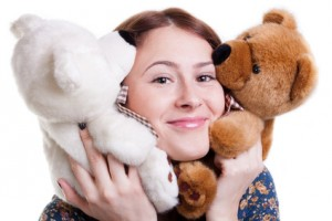 Young girl with two teddy bears