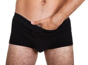 Man putting hand in underwear